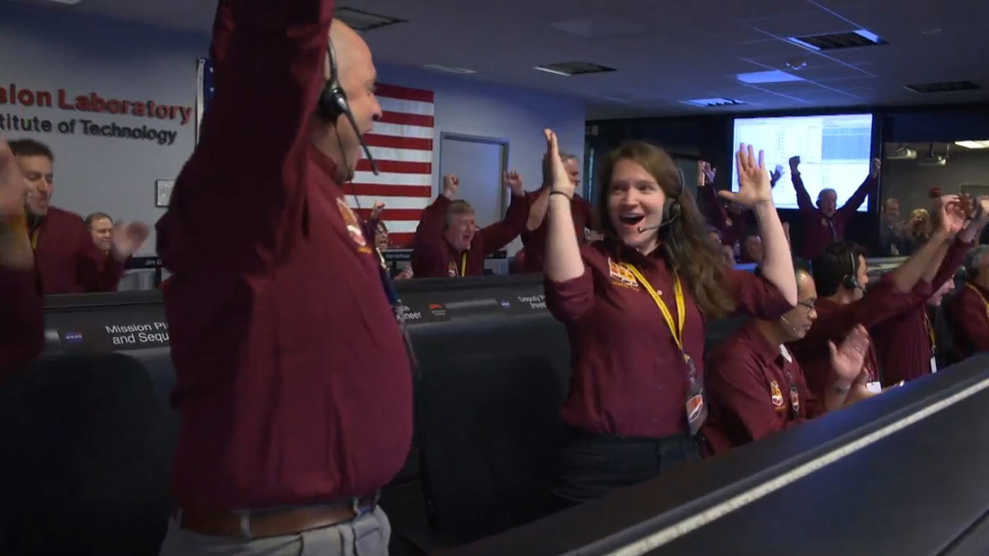 slide 1 - The NASA InSight team at NASA's Jet Propulsion Laboratory in Pasadena, California, reacts after receiving confirmation that the spacecraft successfully touched down on the surface of Mars on Nov. 26, 2018.