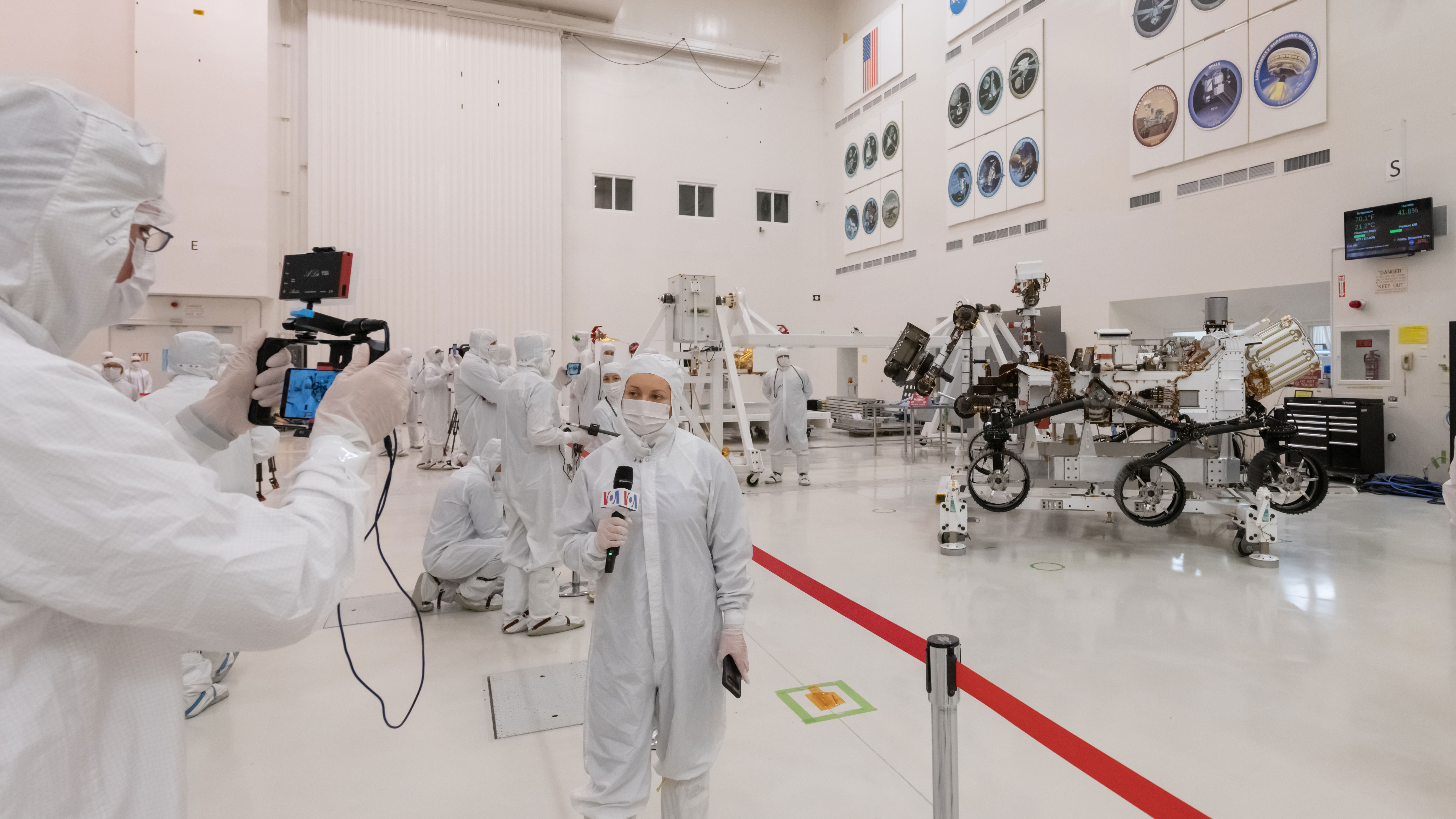 slide 3 - Media get a close-up of NASA's next Mars explorer at NASA's Jet Propulsion Laboratory's clean room.