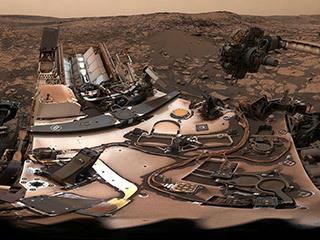 read the article 'Curiosity Surveys a Mystery Under Dusty Skies'