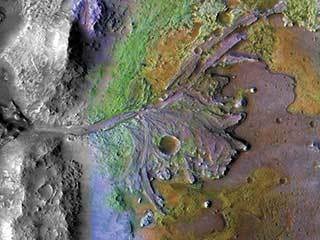 On ancient Mars, water carved channels and transported sediments to form fans and deltas within lake basins.