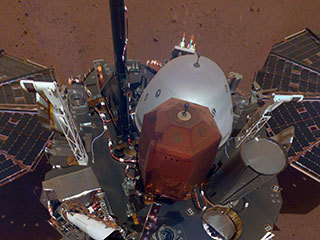 The white east- and west-facing booms — called Temperature and Wind for InSight, or TWINS — on the deck of NASA's InSight lander belong to its suite of weather sensors.