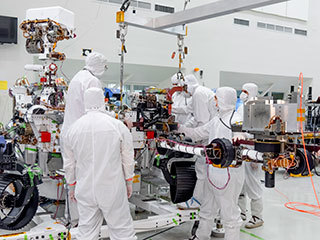 read the article 'Mars 2020 Rover's 7-Foot-Long Robotic Arm Installed'