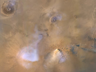 read the article 'Global Storms on Mars Launch Dust Towers Into the Sky'