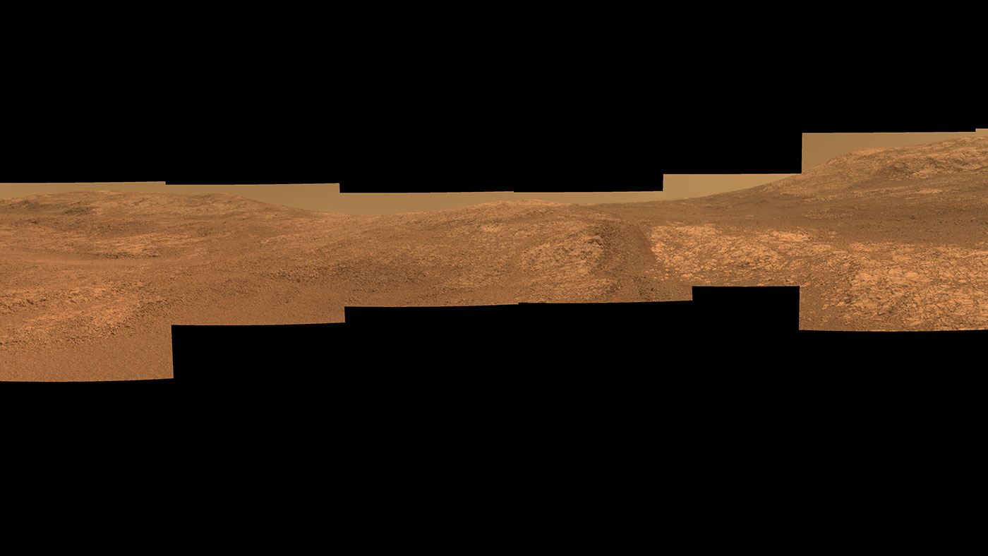 """Perseverance Valley,"" on the rim of Endurance Crater, includes wheel tracks from the Opportunity Mars rover's descent of the valley to investigate its origin. The rover's Pancam took component images in September and October of 2017 for this approximately true-color scene.