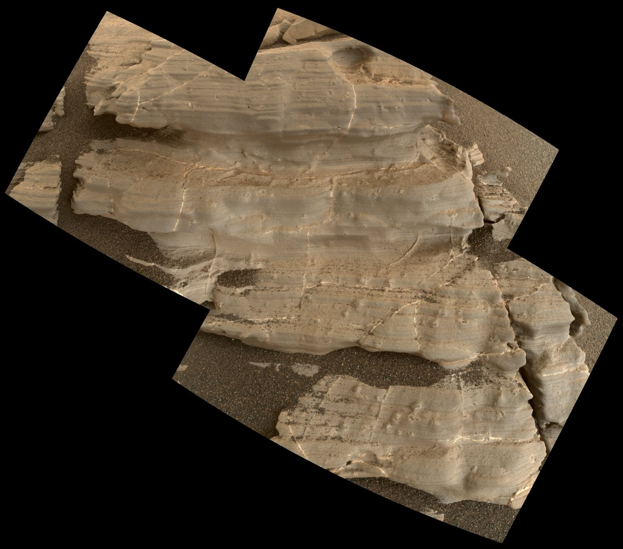 "This exposure of finely laminated bedrock on Mars includes tiny crystal-shaped bumps, plus mineral veins with both bright and dark material. This rock target, called ""Jura,"" was imaged by the MAHLI camera on NASA's Curiosity Mars rover on Jan. 4, 2018, during Sol 1925 of the mission. Credits: NASA/JPL-Caltech/MSSS