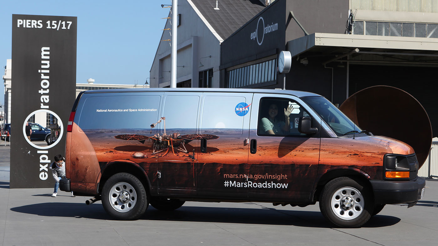 The Mars InSight Roadshow van at San Francisco's Exploratorium in April 2018. The Roadshow van will stop at different California venues to share public exhibits and lectures about NASA's InSight mission.