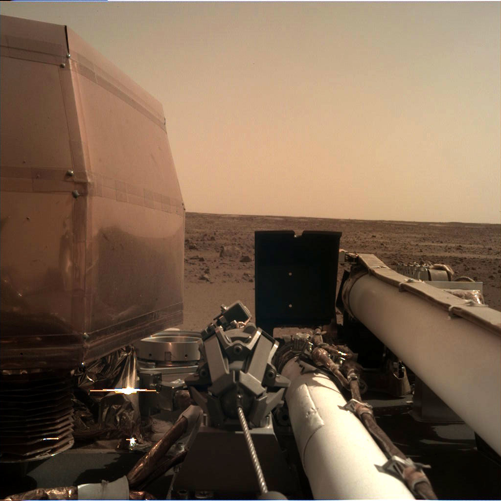 The Instrument Deployment Camera (IDC), located on the robotic arm of NASA's InSight lander, took this photo on the surface of Mars.