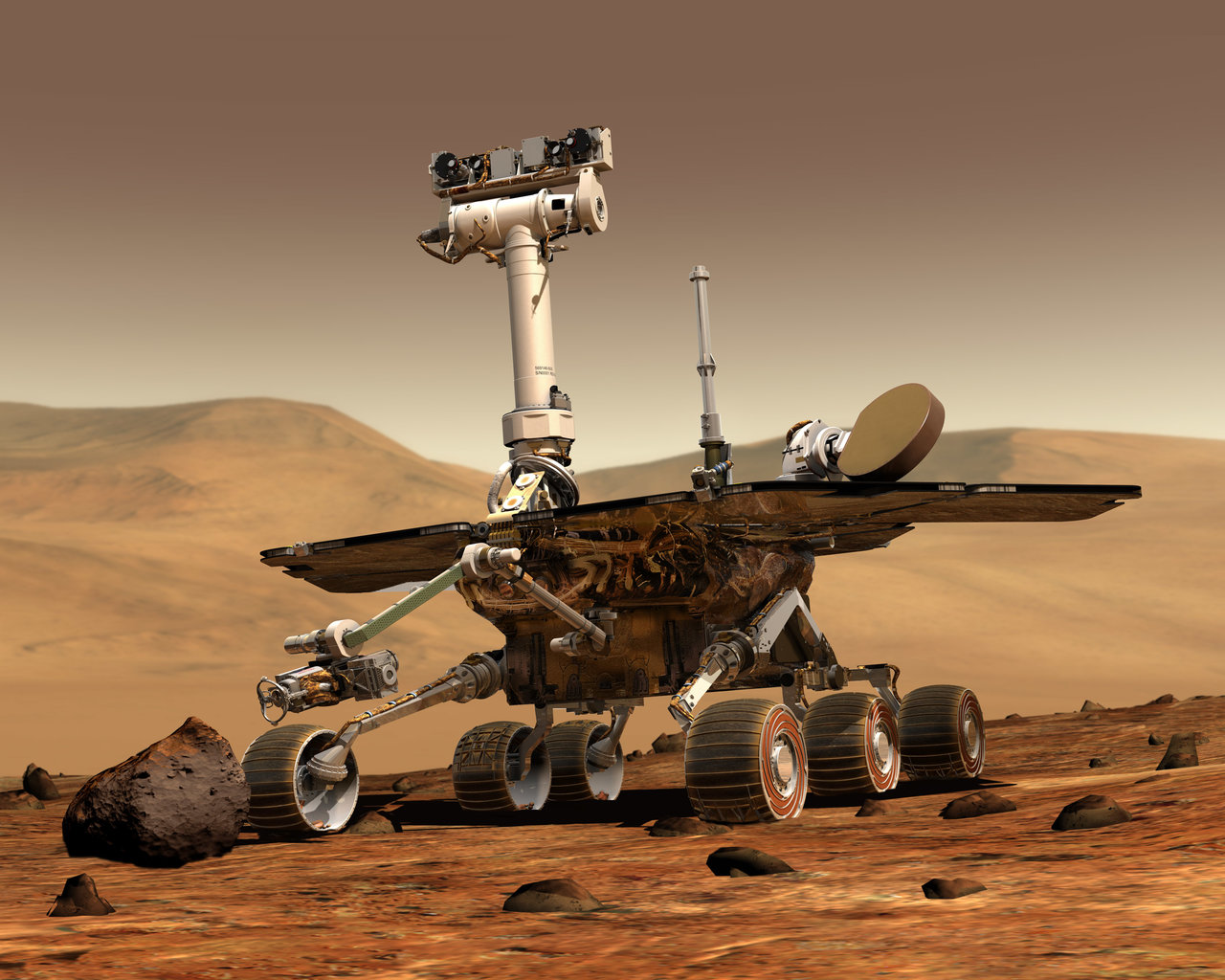 An artist's concept portrays a NASA Mars Exploration Rover on the surface of Mars. Credit: NASA/JPL/Cornell University.