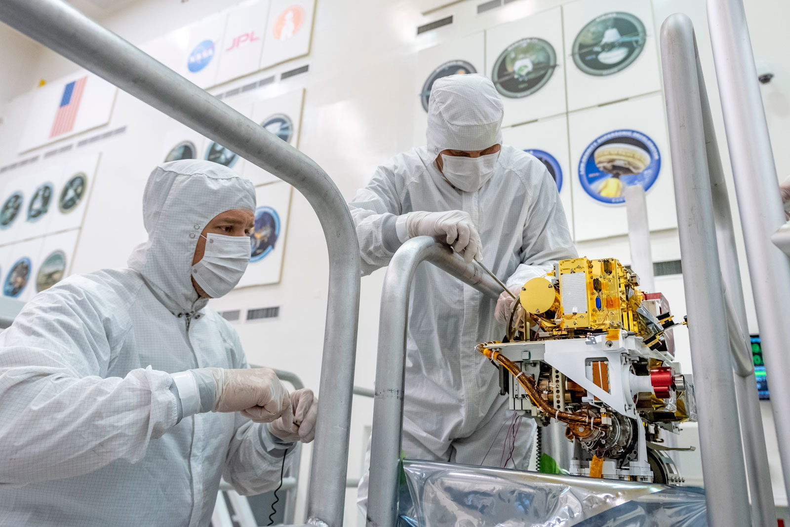 Engineers install the SuperCam instrument on Mars 2020's rover. This image was taken on June 25, 2019, in the Spacecraft Assembly Facility at NASA's Jet Propulsion Laboratory, Pasadena, California.