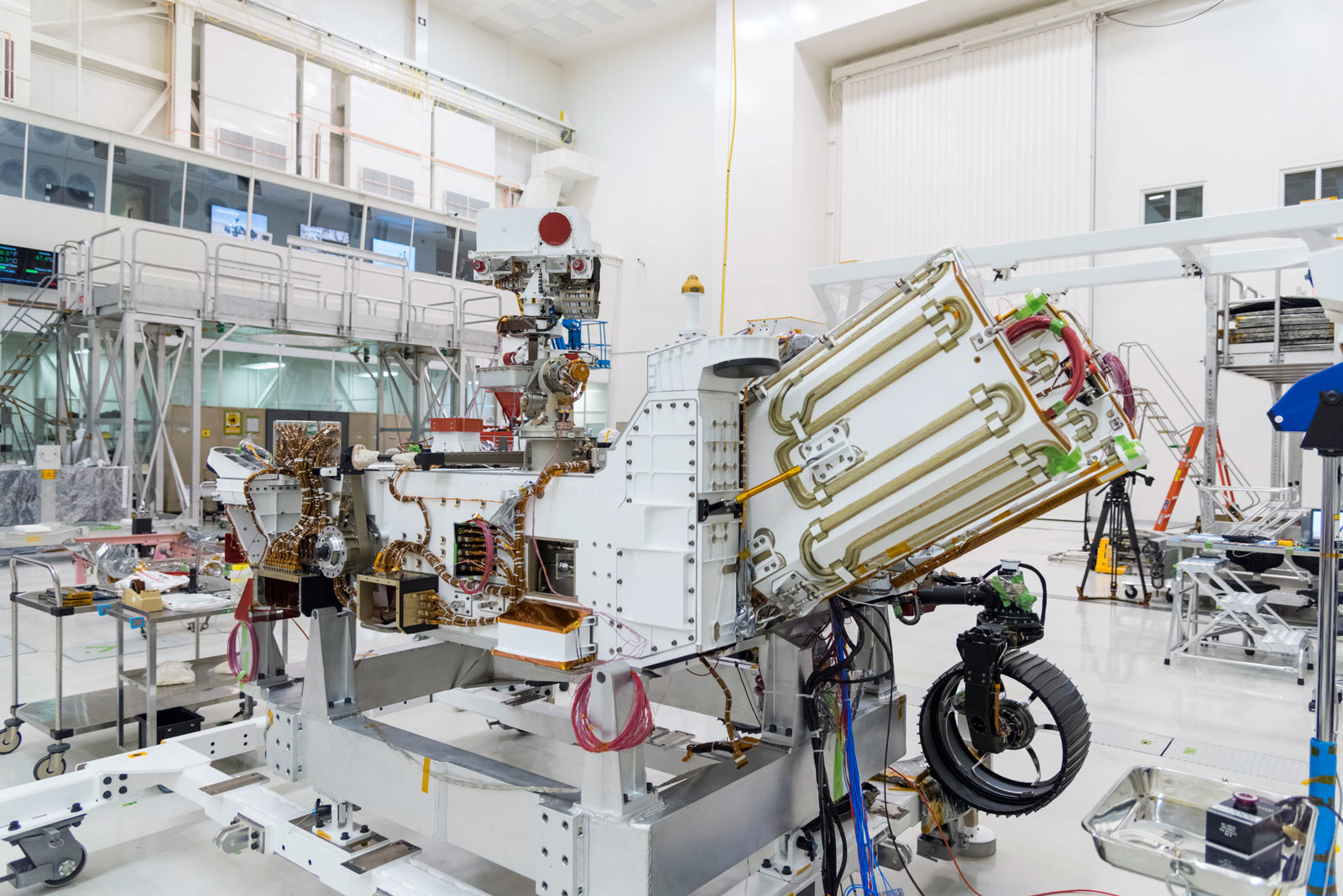 The electricity for NASA's Mars 2020 rover is provided by a power system called a Multi-Mission Radioisotope Thermoelectric Generator, or MMRTG. The MMRTG will be inserted into the aft end of the rover between the panels with gold tubing visible at the rear, which are called heat exchangers.