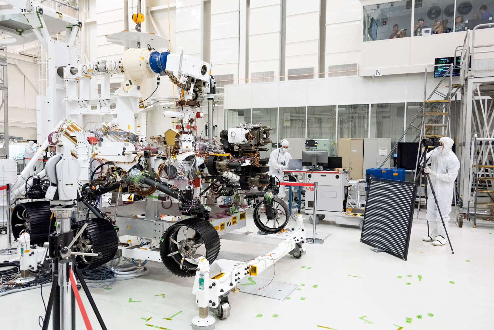 In this image, engineers test cameras on the top of the Mars 2020 rover's mast and front chassis. The image was taken on July 23, 2019, in the Spacecraft Assembly Facility's High Bay 1 at NASA's Jet Propulsion Laboratory in Pasadena, California.