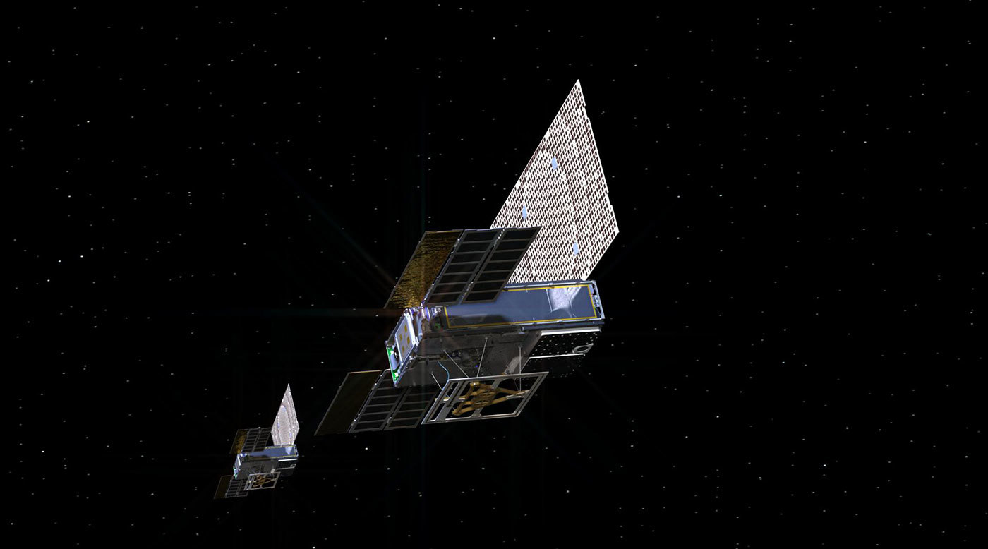 An artist's rendering of the twin Mars Cube One (MarCO) spacecraft as they fly through deep space.
