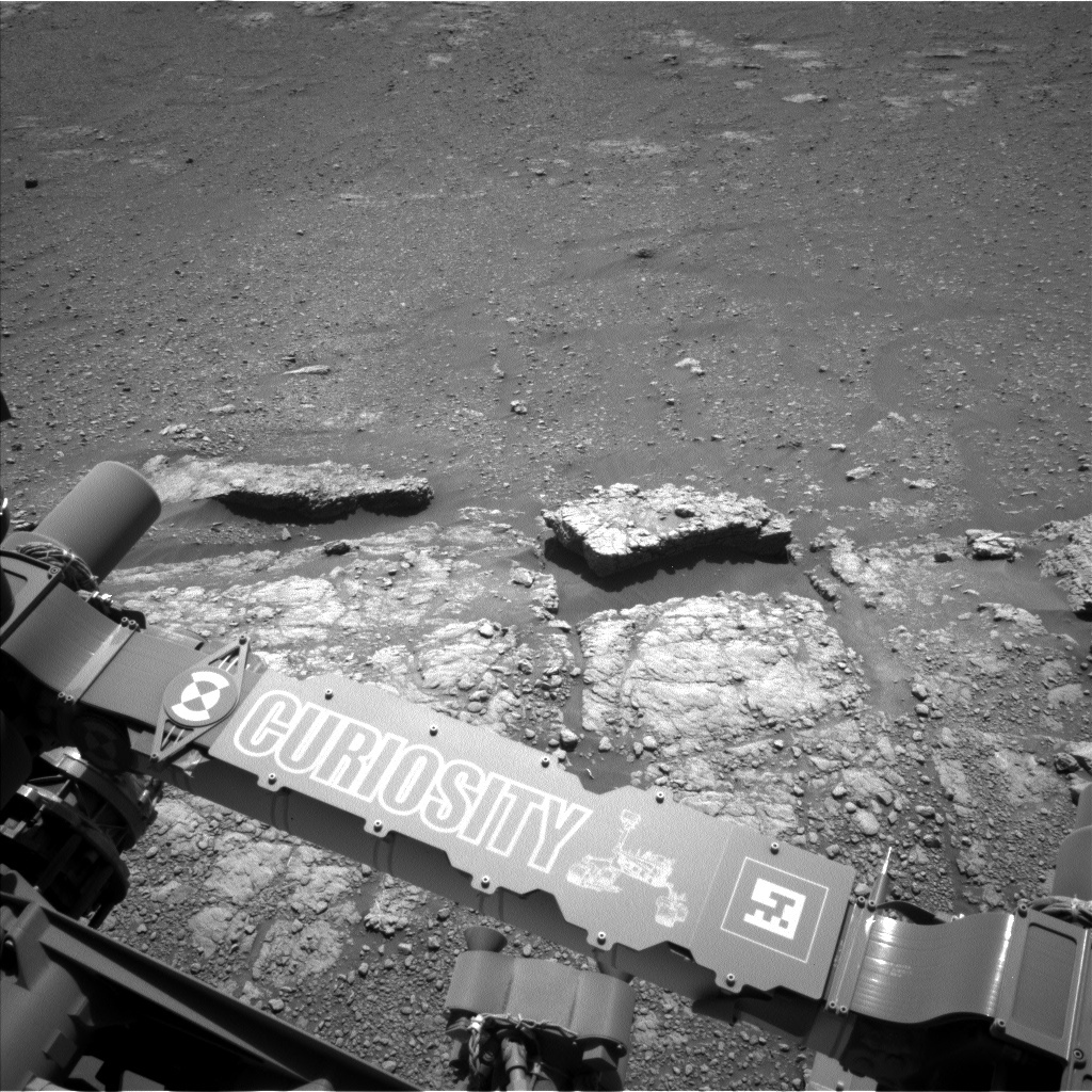 "A view of possible pebble-forming rocks in front of the rover. A rock designated as ""Quarff"" is in the middle-left of the image."