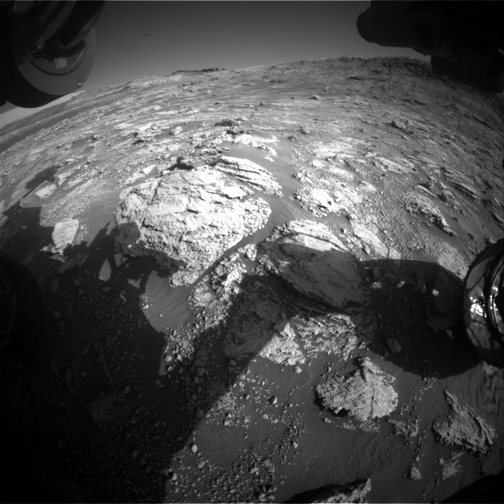 The shadow of Curiosity's arm in the new workspace.
