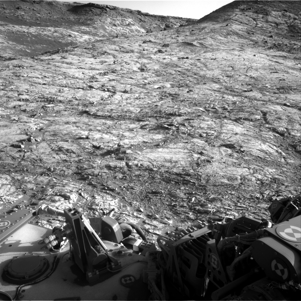 Navcam right image looking south-southeast with light coloured mudstone in the foreground. One of the darker colored, loose blocks that sit on top of the light rock in the top right of the image is our planned end of drive location.