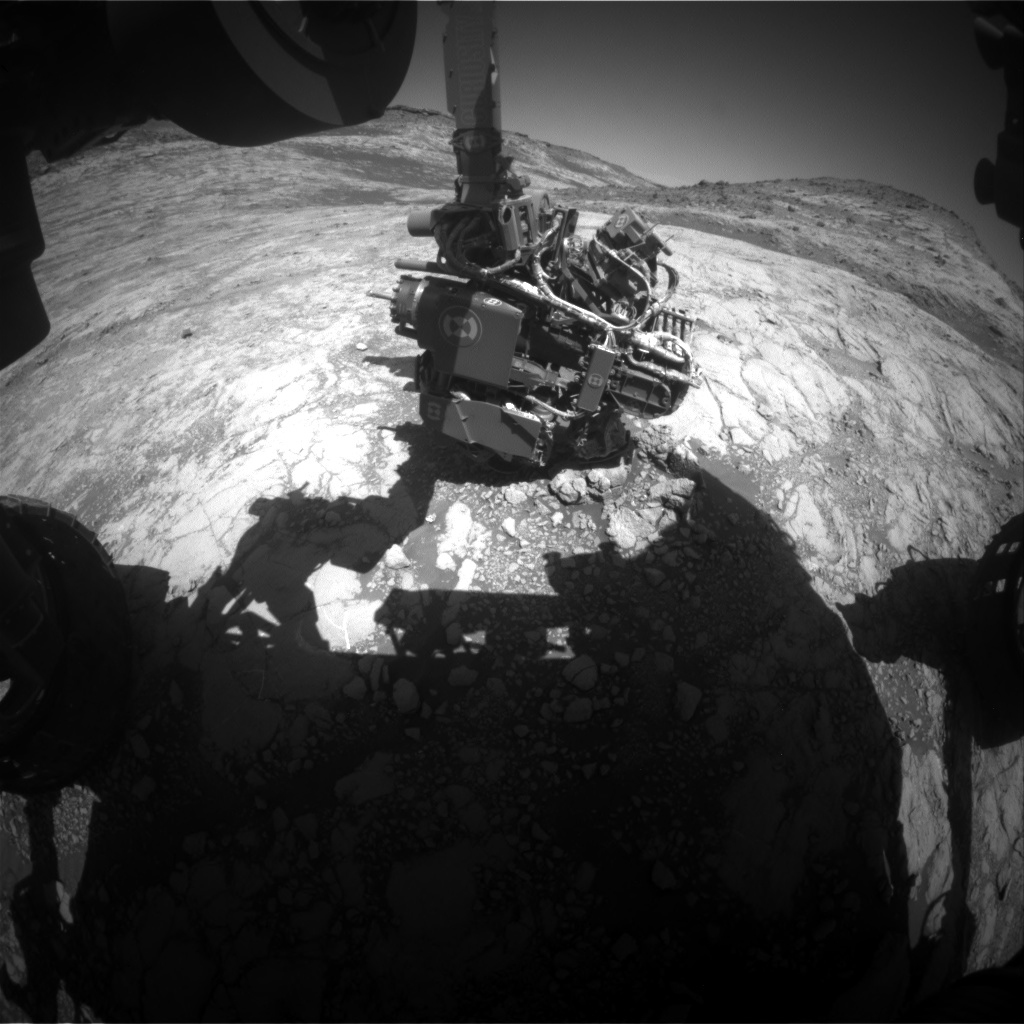 This Hazcam image shows Curiosity's arm extended out to perform an APXS analysis of the bedrock. Curiosity has to know the exact angle of every joint to move safely.