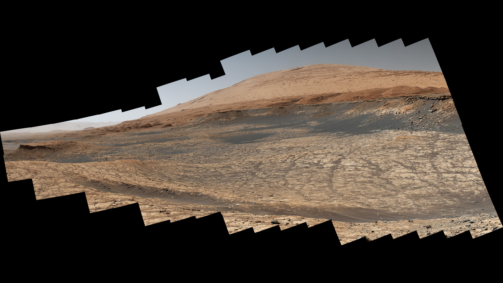 "This view captured by NASA's Curiosity Mars rover shows the path it will take in the summer of 2020 as it drives toward the next region it will be investigating, the ""sulfate-bearing unit."""