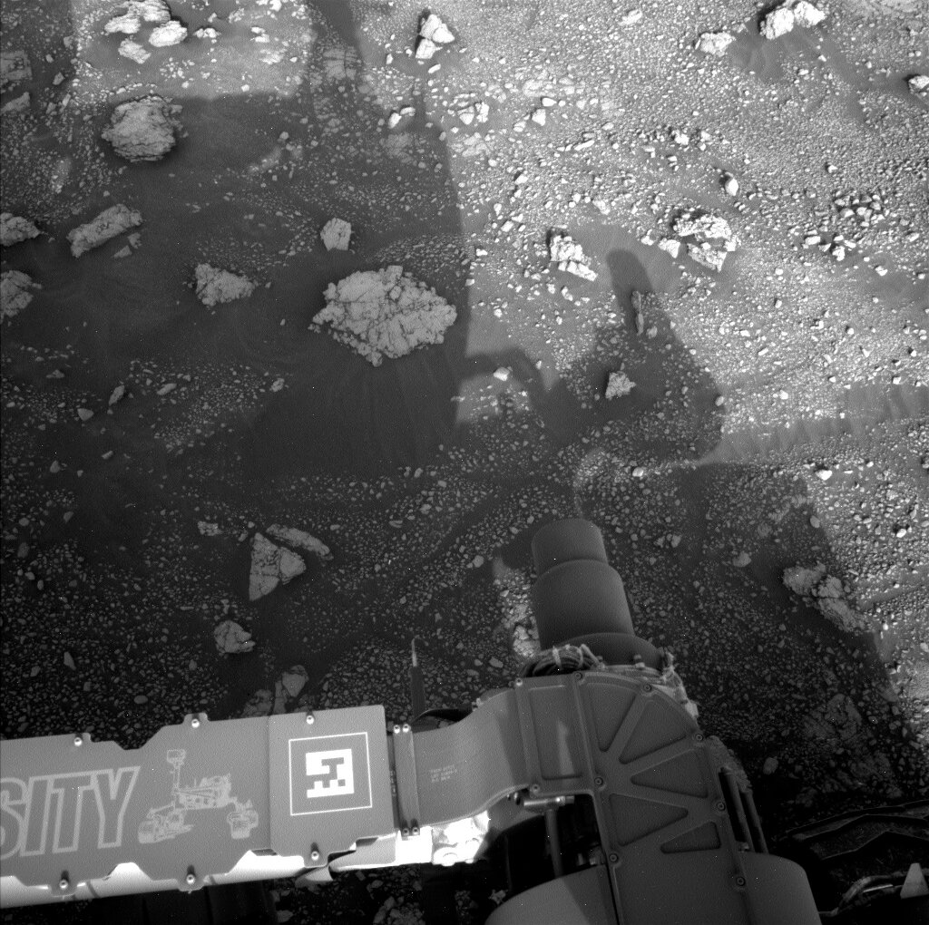 Part of Curiosity rover is visible in this image of Mars