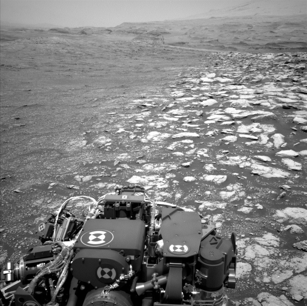 Parts of the Curiosity rover are visible in this Mars panorama