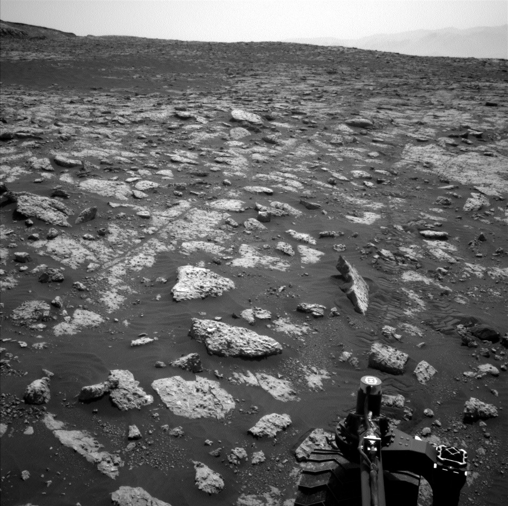 Part of Curiosity rover and a view of Mars