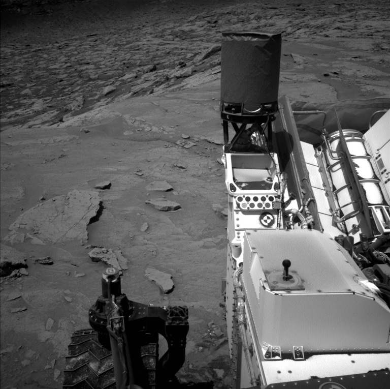Parts of the rover are visible in this Mars view captured by the Left Navigation camera