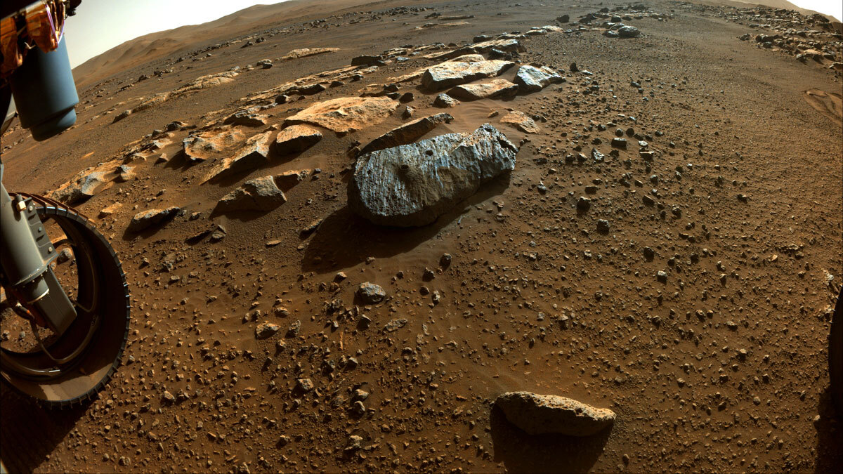"""Image taken by Perseverance with two holes where the rover's drill obtained chalk-size samples from rock nicknamed """"Rochette."""""""