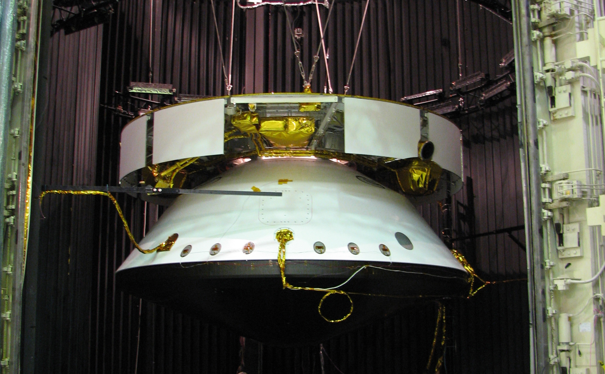 This image shows the Mars Science Laboratory spacecraft is suspended in a dark chamber, awaiting an environmental test.