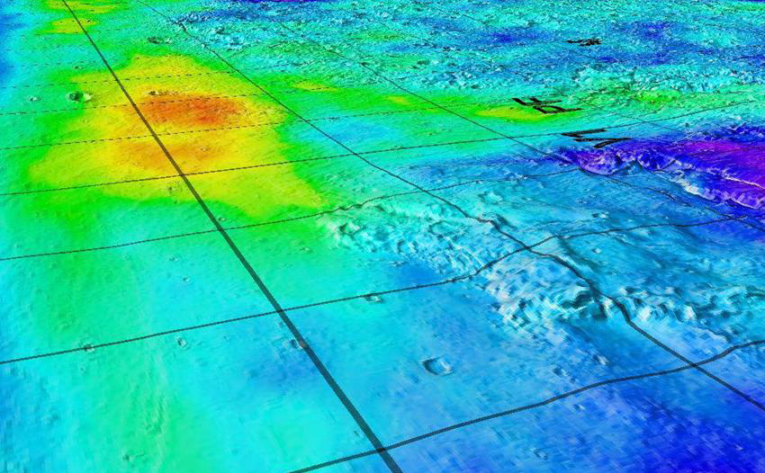 This image superimposes Gamma-Ray Spectrometer data from NASA's Mars Odyssey orbiter onto topographic data from the laser altimeter on NASA's Mars Global Surveyor.