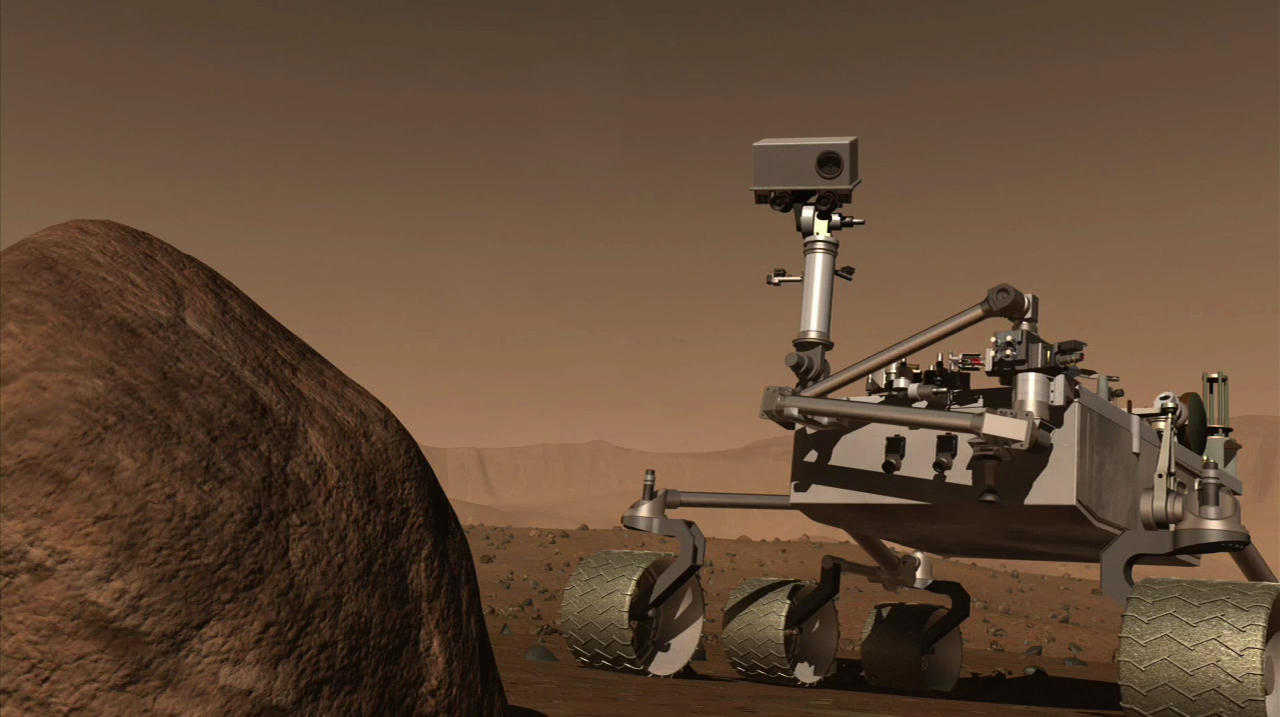 This artists concept of MSL is a still from the MSL Mission Overview video. It shows MSL on the surface of Mars.