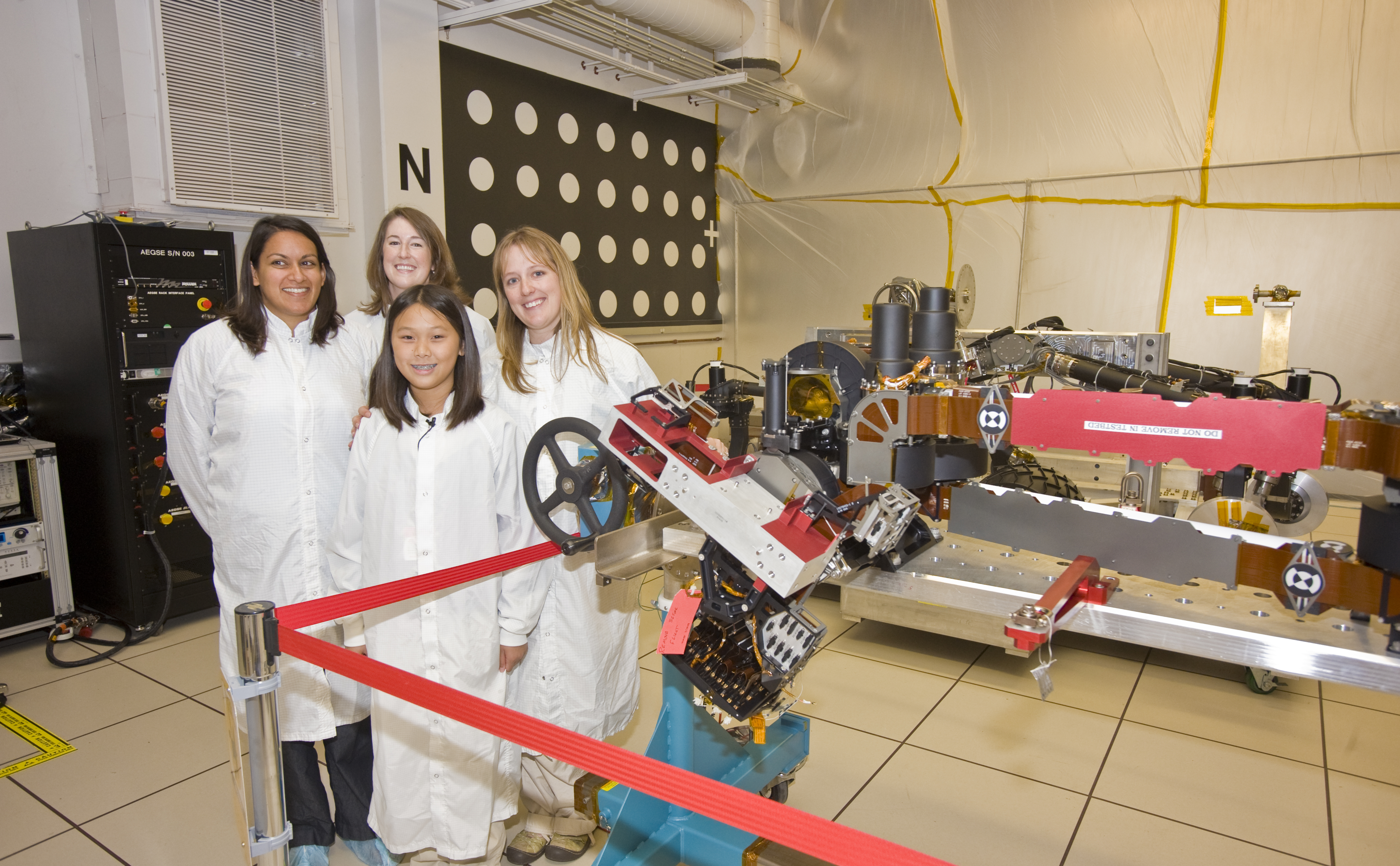 Clara Ma (in front) with Suparna Mukherjee, Julie Townsend, Jaime Waydo (in back row) are featured here in the laboratory where an engineering model of the next Mars rover, Curiosity, is being tested.
