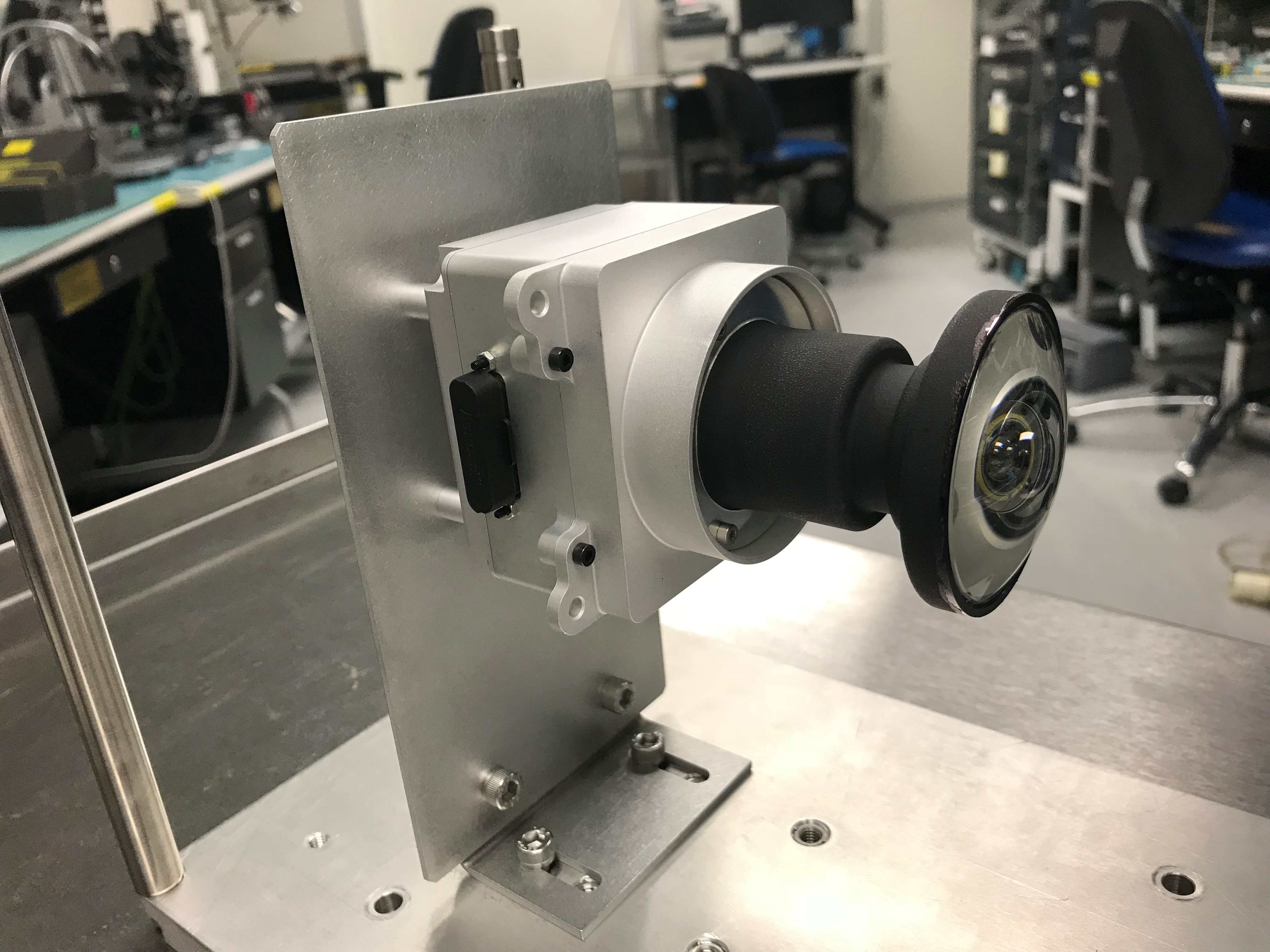 One of the enhanced engineering cameras with a prototype lens for the Hazcams, which will watch for obstacles encountered by the Mars 2020 rover.