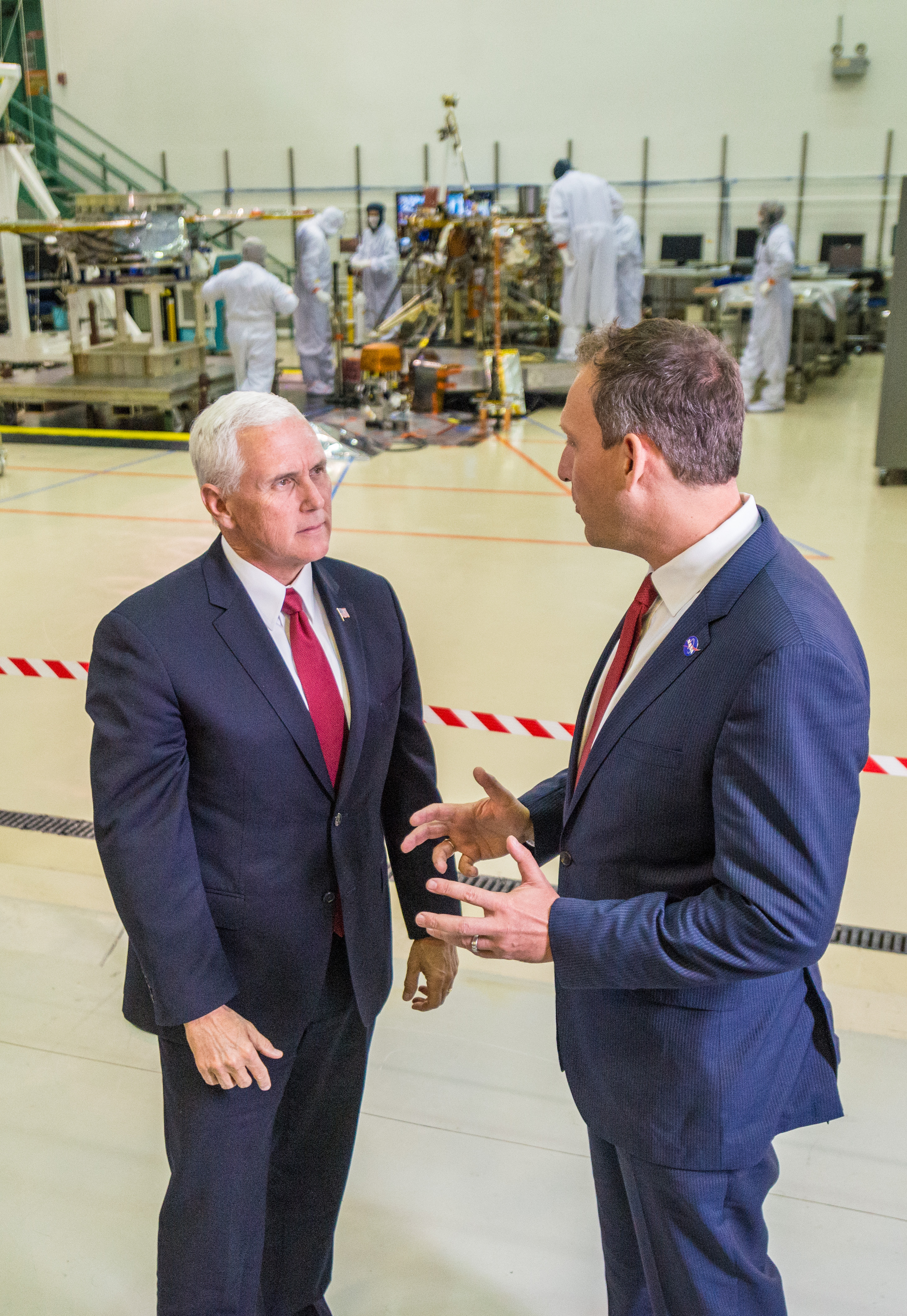 Vice President Mike Pence, left, speaks with Thomas Zurbuchen, NASA's associate administrator for the Science Mission Directorate, right, in a clean room facility near Denver, Colorado, where Lockheed Martin Space Systems is assembling and testing InSight, NASA's next spacecraft to Mars.