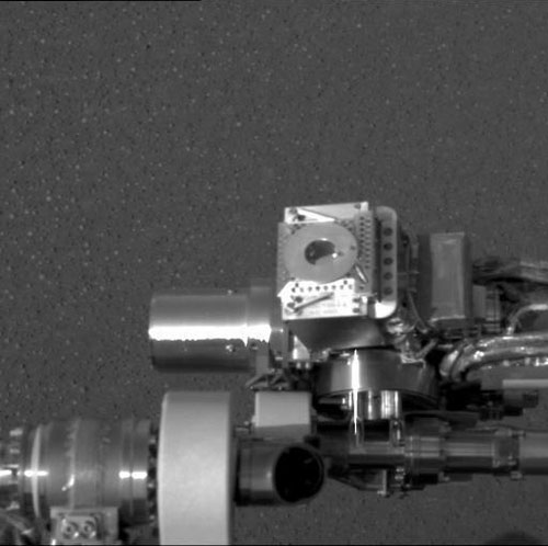 This black and white image taken on the plains of Meridiani Planum, Mars highlights Opportunity's Moessbauer spectrometer on the end of the rover 'arm.'