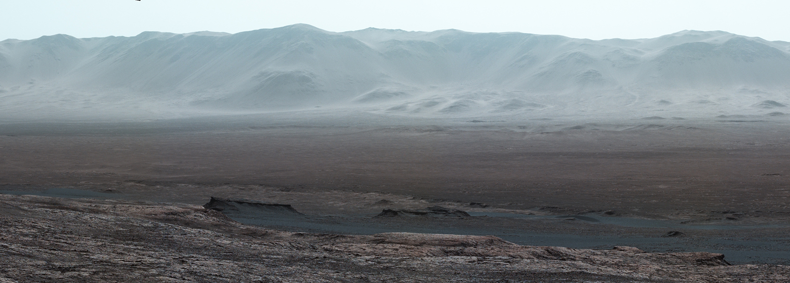 "Climbing ""Vera Rubin Ridge"" provided NASA's Curiosity Mars rover this vista of the interior and rim of Gale Crater, including much of the rover's route since its 2012 landing and features up to about 50 miles away. The left-eye camera of the rover's Mastcam took the component images Oct. 25, 2017."