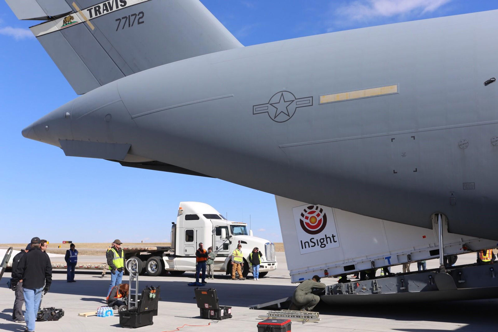Personnel supporting NASA's InSight mission to Mars load the crated InSight spacecraft into a C-17 cargo aircraft at Buckley Air Force Base, Denver, for shipment to Vandenberg Air Force Base, California. The spacecraft, built in Colorado by Lockheed Martin Space, was shipped February 28, 2018, in preparation for launch from Vandenberg in May 2018.