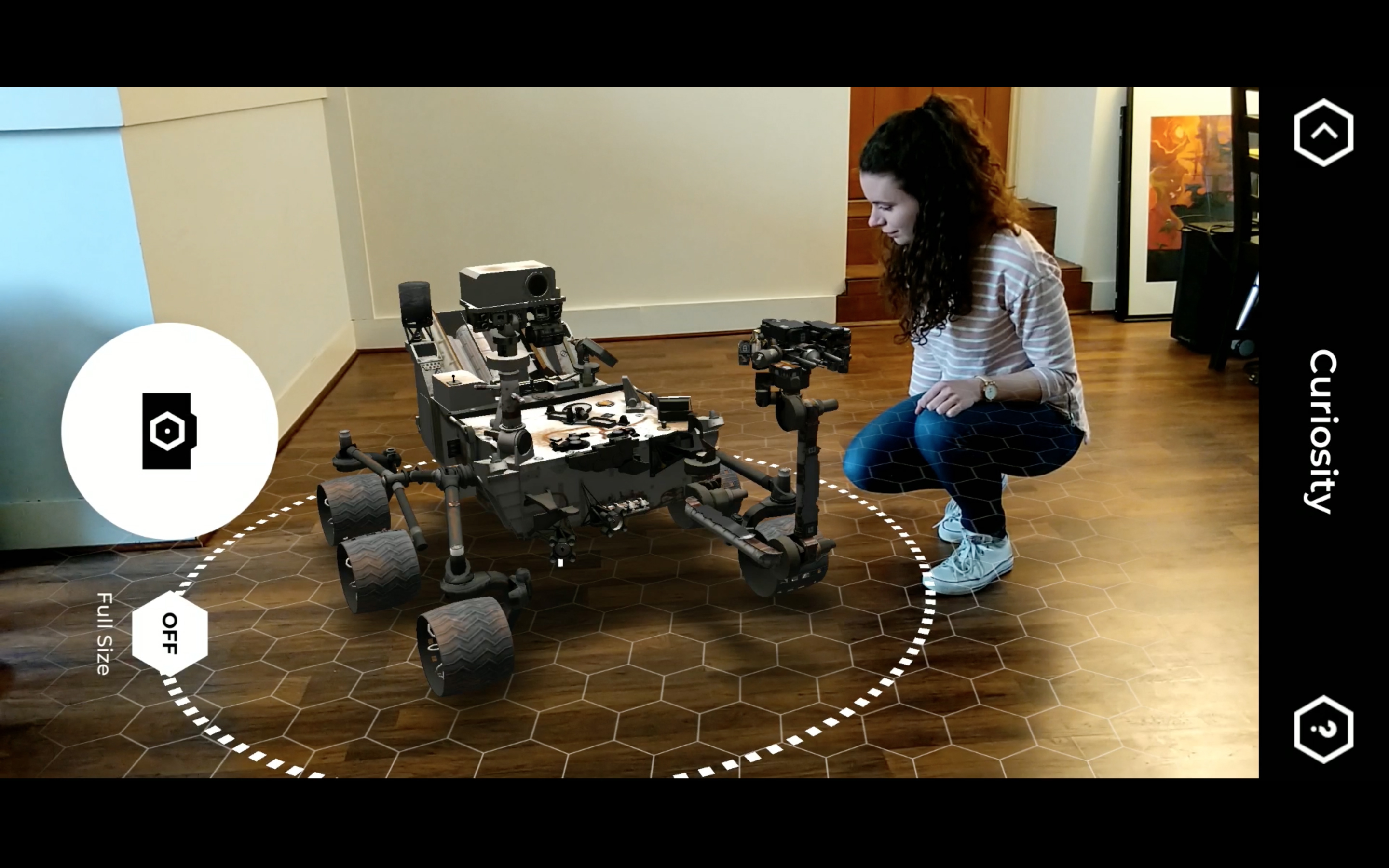 woman kneeling by augmented-reality rover