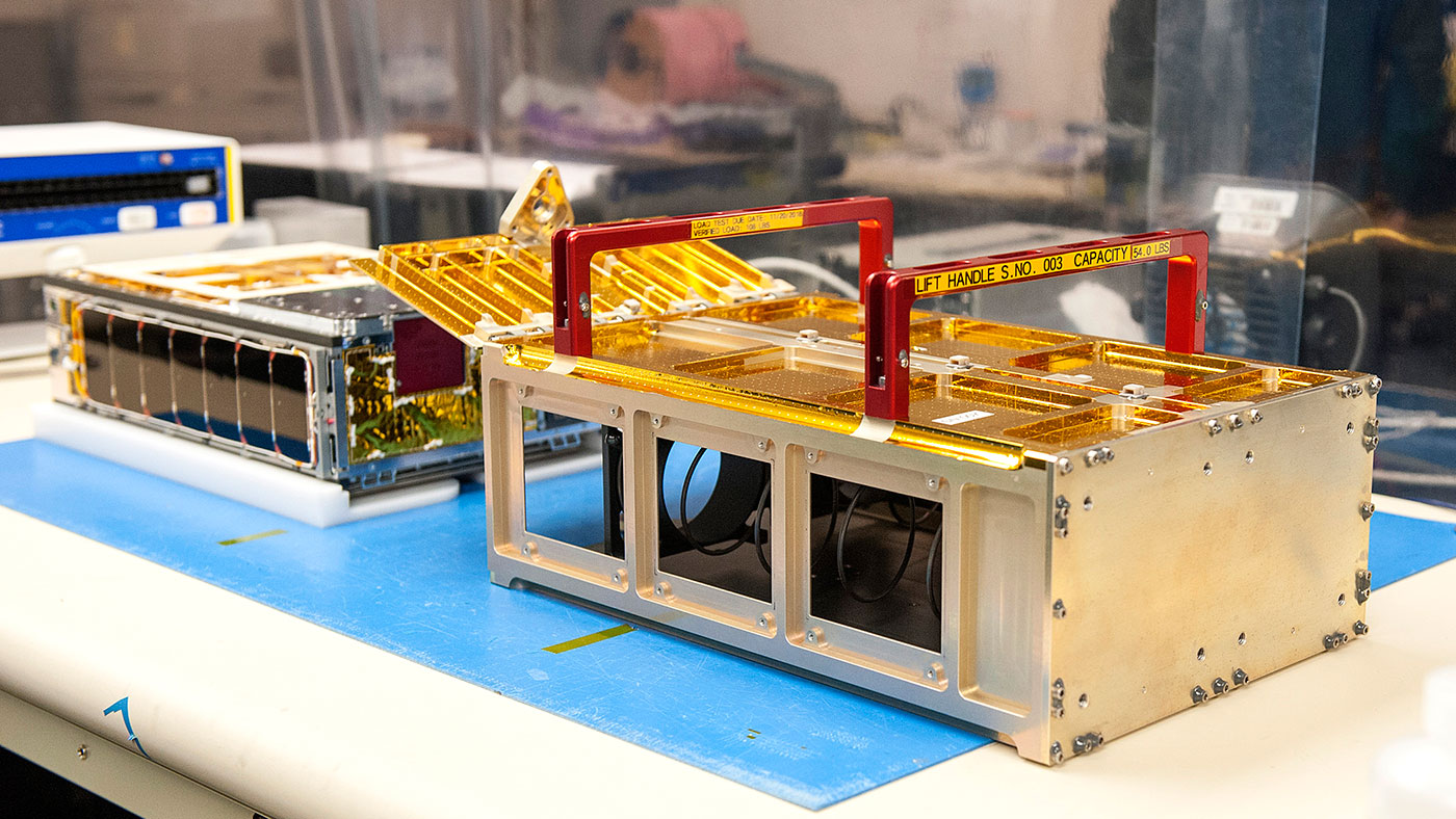One of the MarCO CubeSats inside a cleanroom at Cal Poly San Luis Obispo, before being placed into its deployment box.