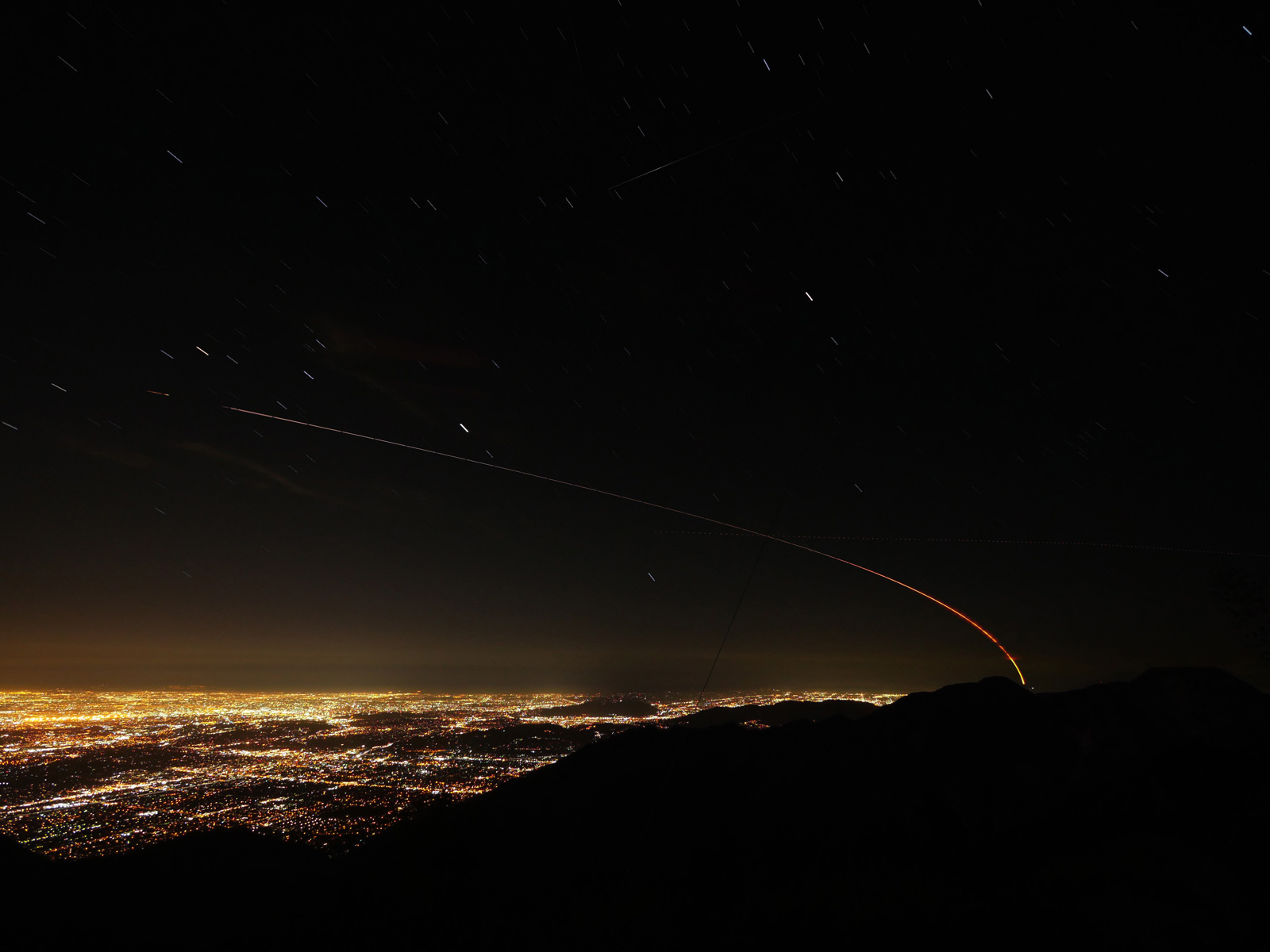 This image shows the trail of NASA's Mars InSight lander over the Los Angeles area after launching from Vandenberg Air Force Base in Central California on May 5, 2018. This is a stack of exposures taken from Mt. Wilson.