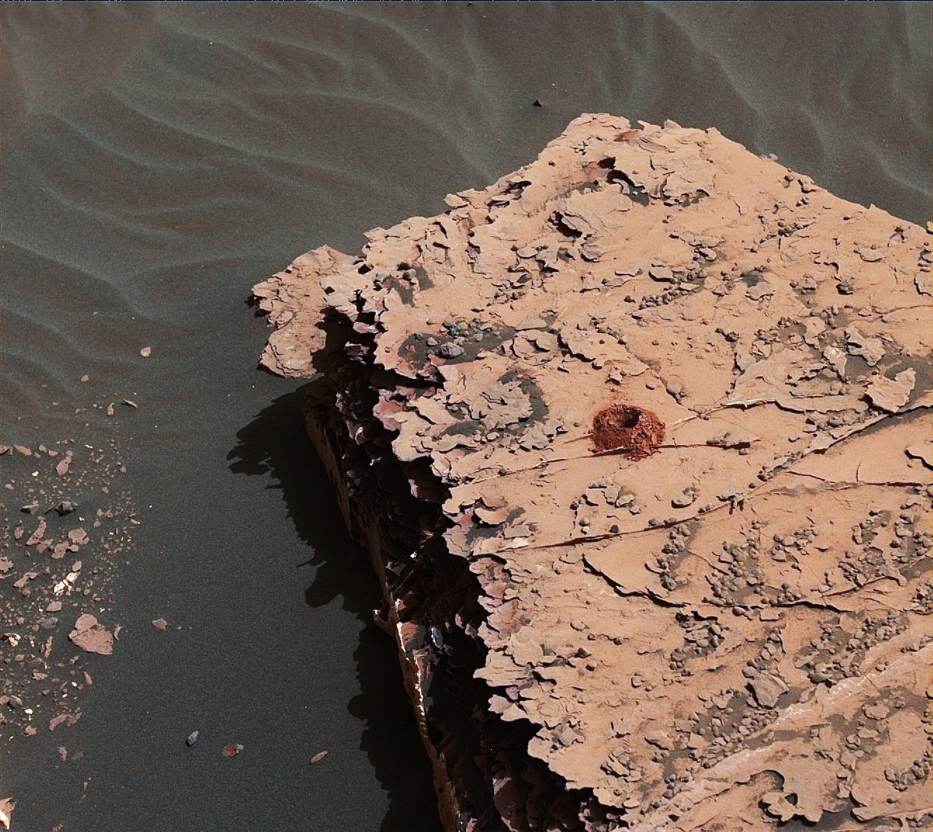 "NASA's Curiosity rover successfully drilled a 2-inch-deep hole in a target called ""Duluth"" on May 20. It was the first rock sample captured by the drill since October 2016. This image was taken by Curiosity's Mast Camera (Mastcam) on Sol 2057."