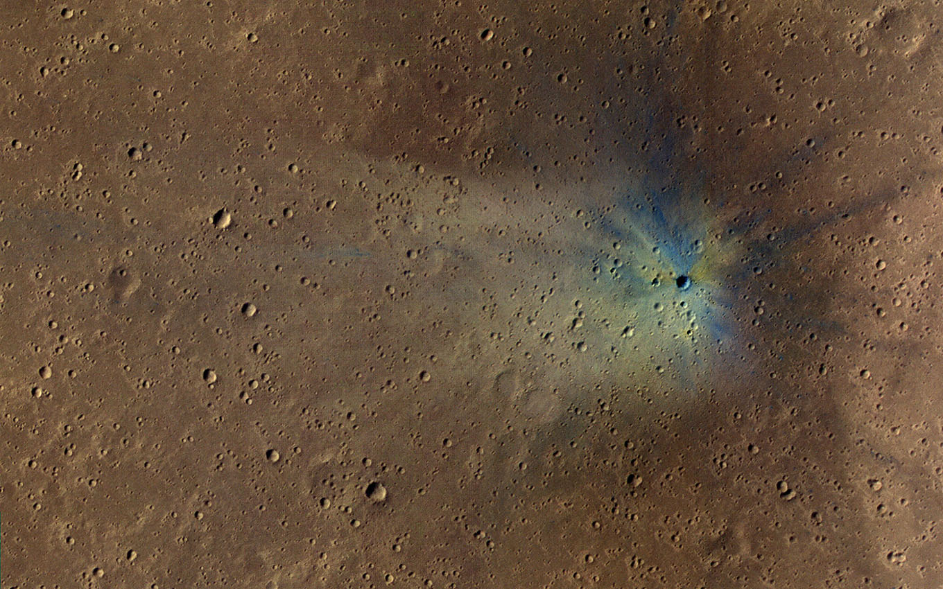 This is an image from NASA's Mars Reconnaissance Orbiter of a new impact site on Mars, within the dense secondary crater field of Corinto Crater.