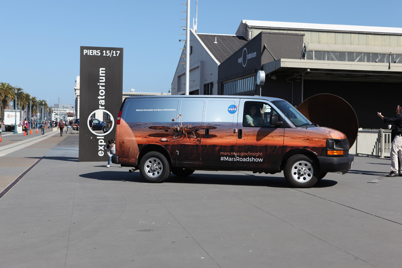 This is an image of the Mars InSight Roadshow van at San Francisco's Exploratorium in April 2018.