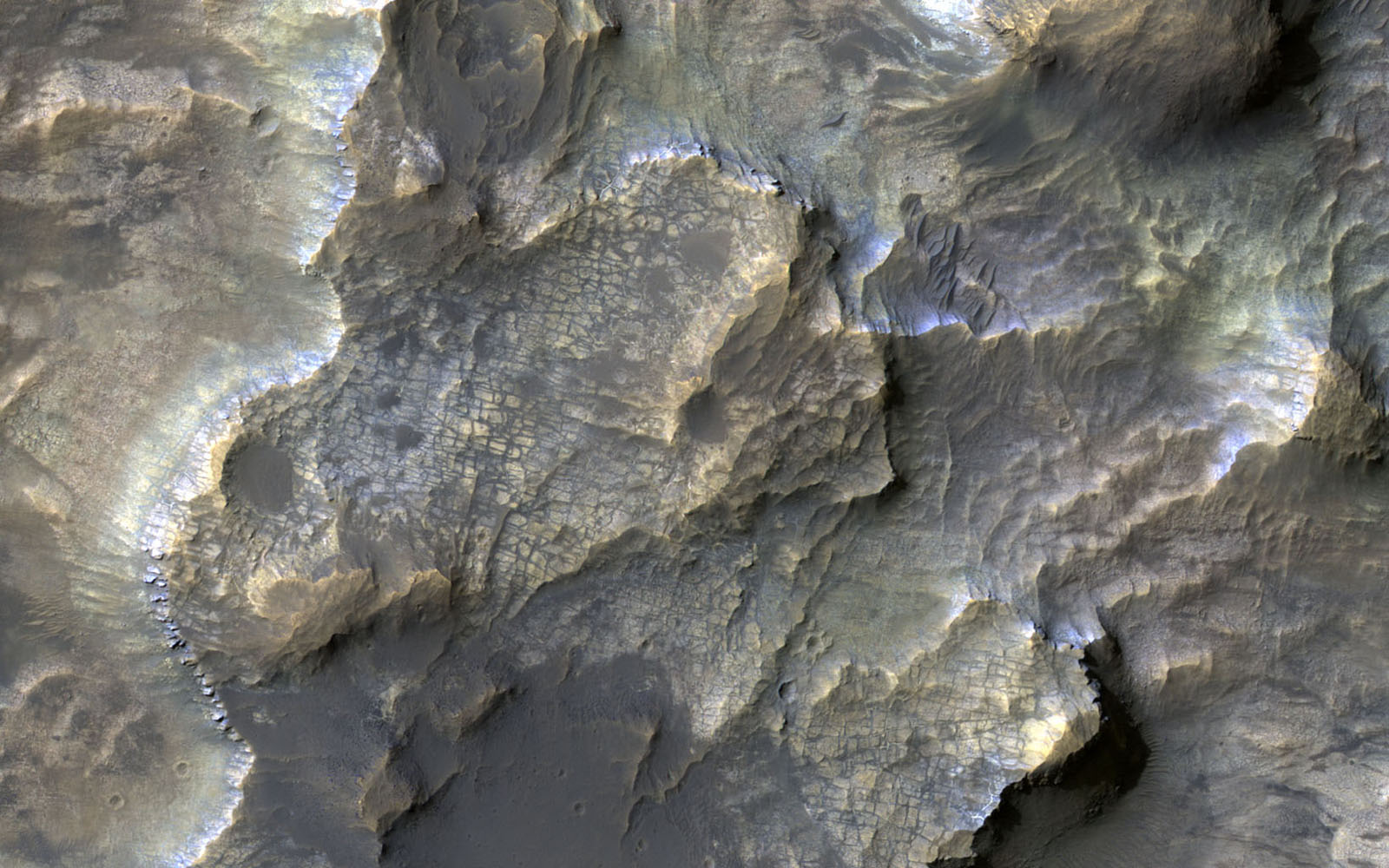 This colorful image acquired on May 21, 2018 by NASA's Mars Reconnaissance Orbiter shows clays within the Eridania basin region. A large lake may have once existed here.