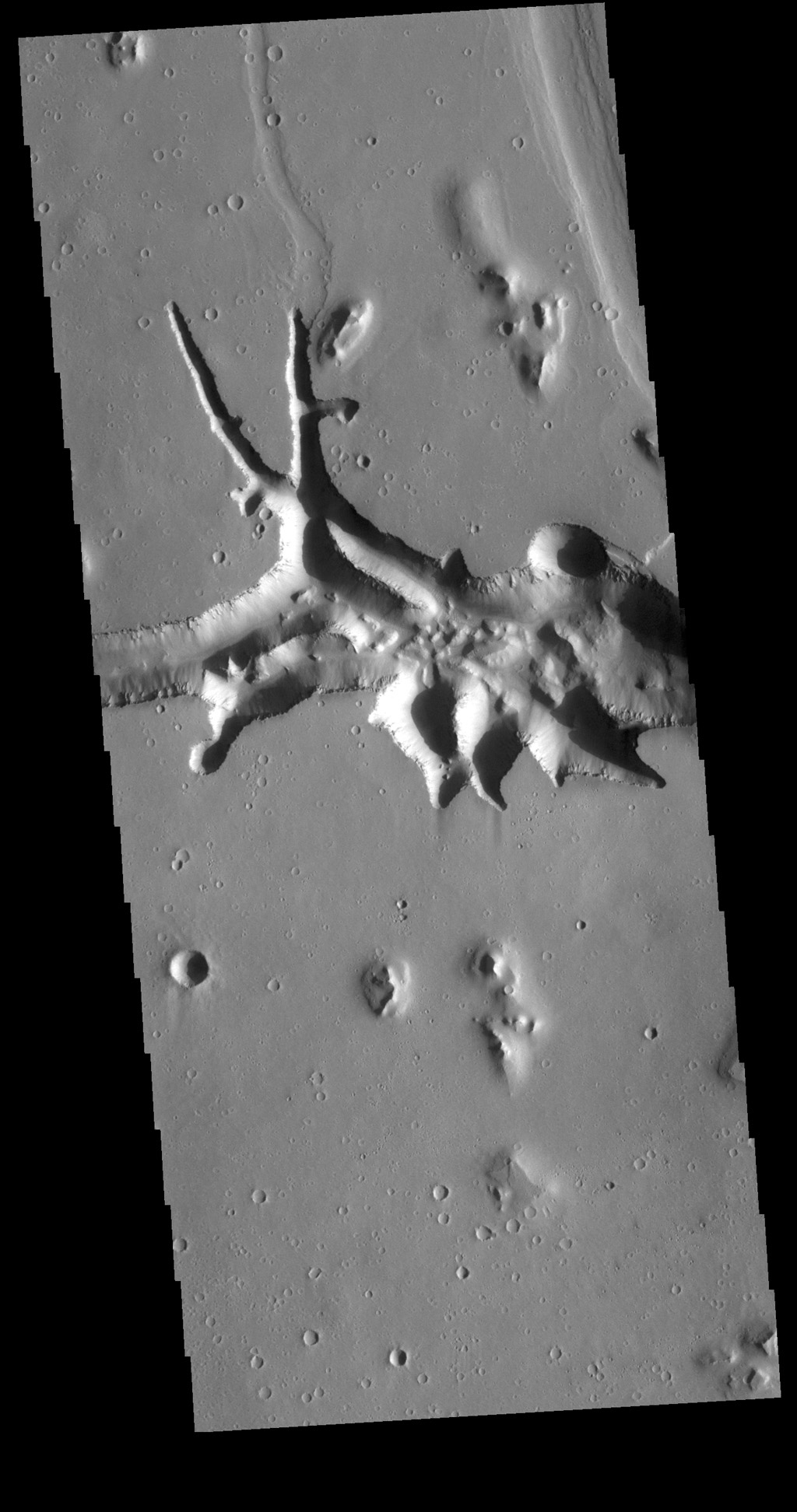 This image from NASA's Mars Odyssey shows the eastern end of Hephaestus Fossae, which is a channel system in Utopia Planitia near Elysium Mons.