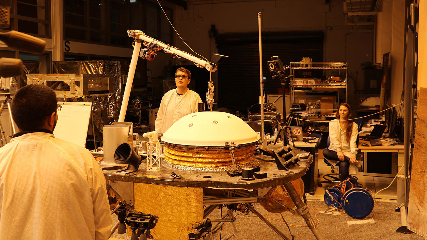 NASA's InSight mission tests an engineering version of the spacecraft's robotic arm in a Mars-like environment at NASA's Jet Propulsion Laboratory.