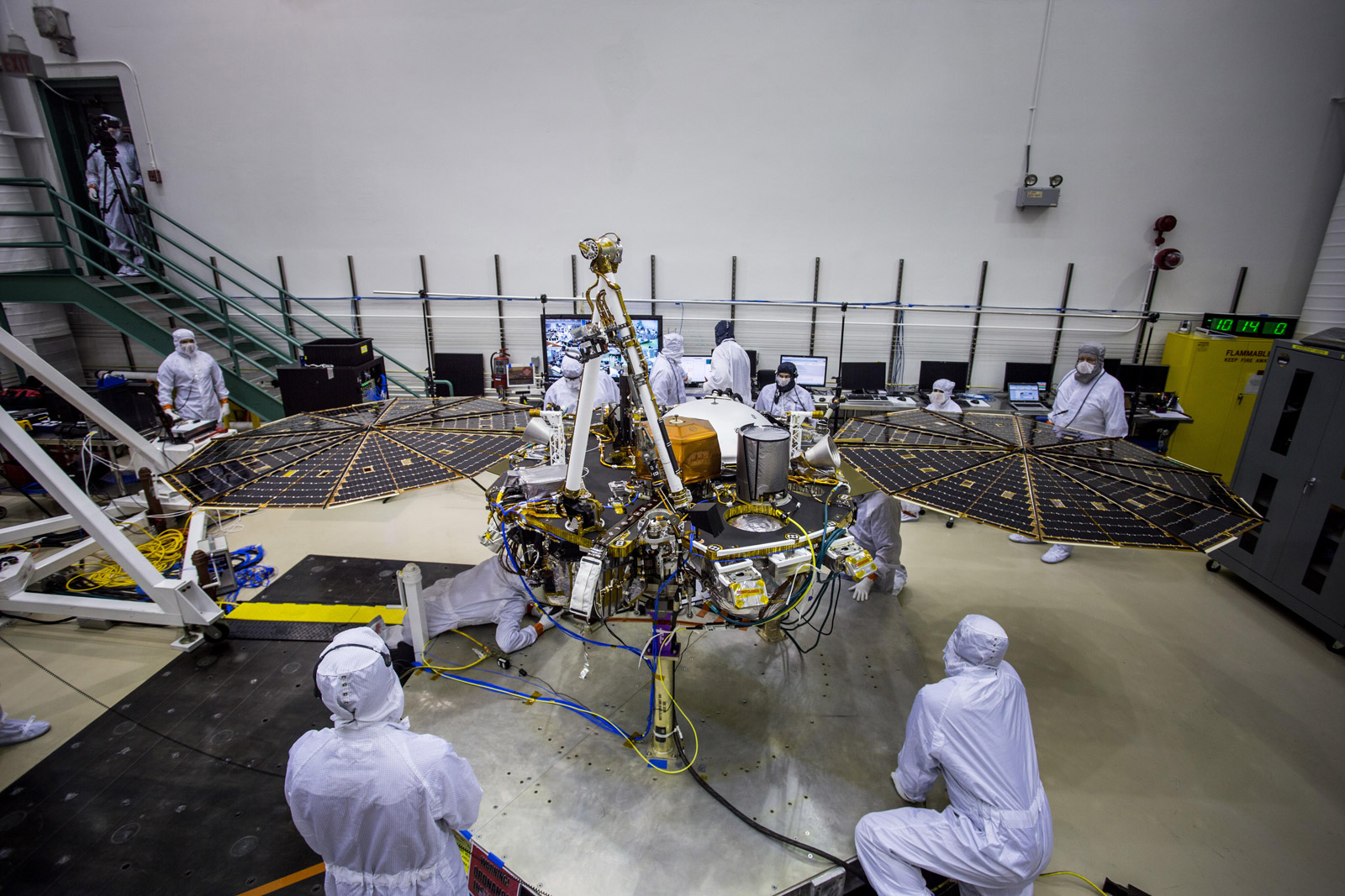 Engineers at Lockheed Martin Space, Denver, Colorado, test the solar arrays on NASA's InSight lander several months before launch.