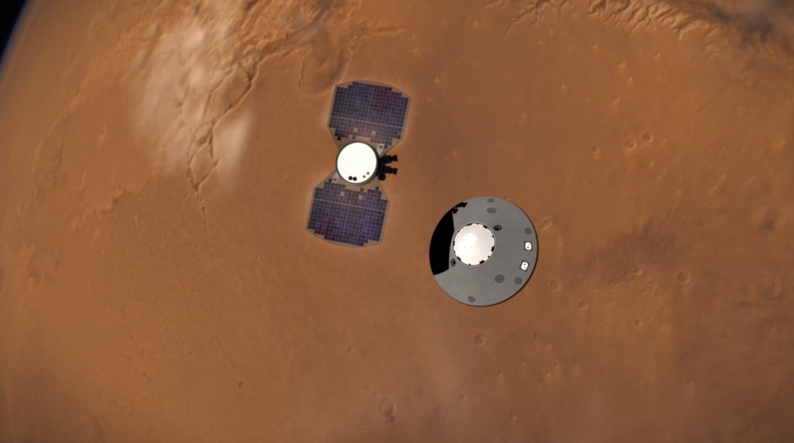 This illustration shows NASA's InSight lander separating from its cruise stage as it prepares to enter Mars' atmosphere. The InSight lander is on the right, tucked inside a protective heat shield and back shell. The cruise stage with solar panels is on the left.