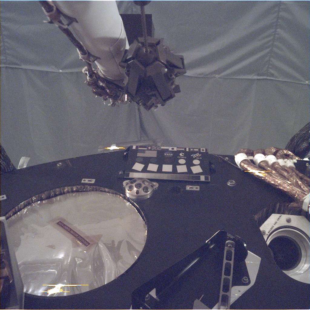 This image of the deck of NASA's InSight lander – where the camera's rectangular calibration target can be seen in the middle -- was taken by the Instrument Deployment Camera during the assembly, test and launch operations phase at Lockheed Martin Space, Denver.