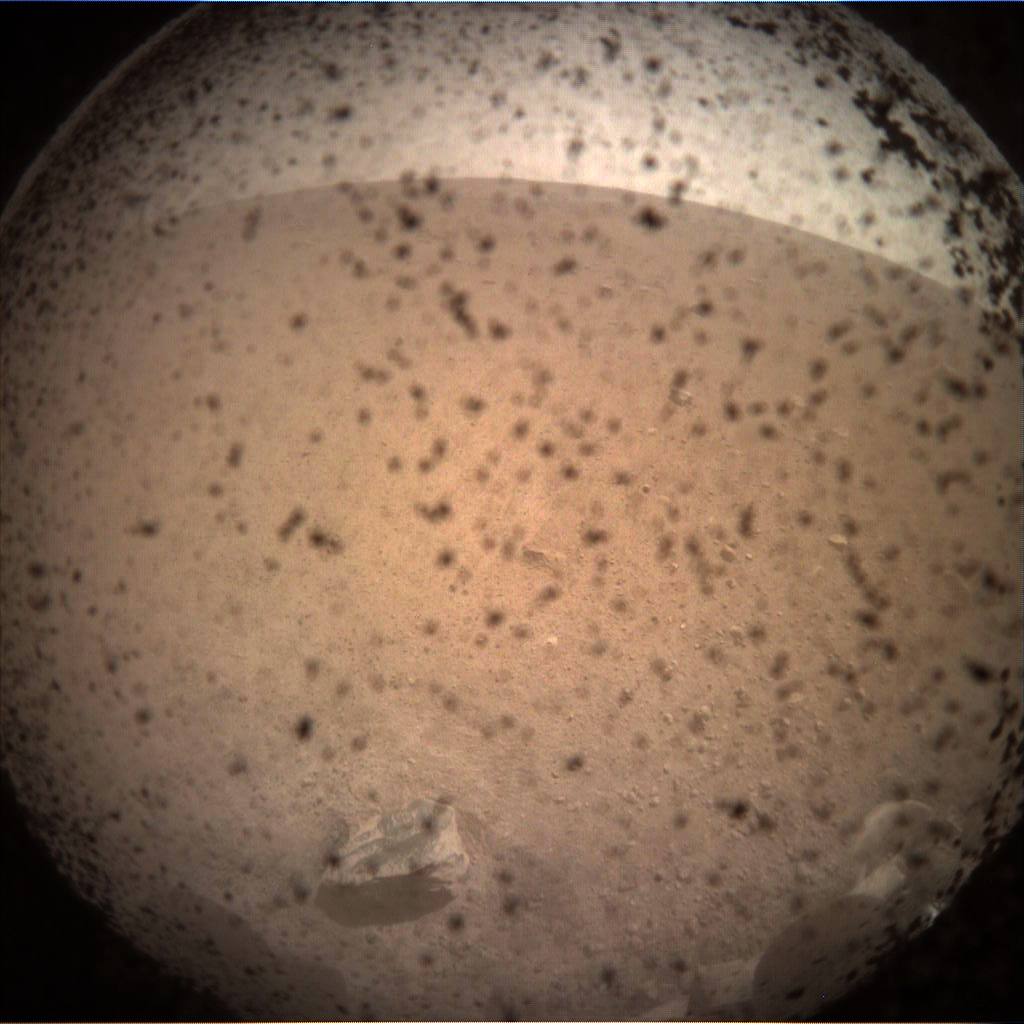 This is the first image taken by NASA's InSight lander on the surface of Mars.