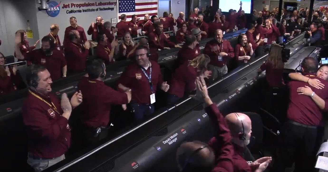 The NASA InSight team reacts after receiving confirmation that the spacecraft successfully touched down on the surface of Mars, inside the Mission Support Area at NASA's Jet Propulsion Laboratory in Pasadena, California.