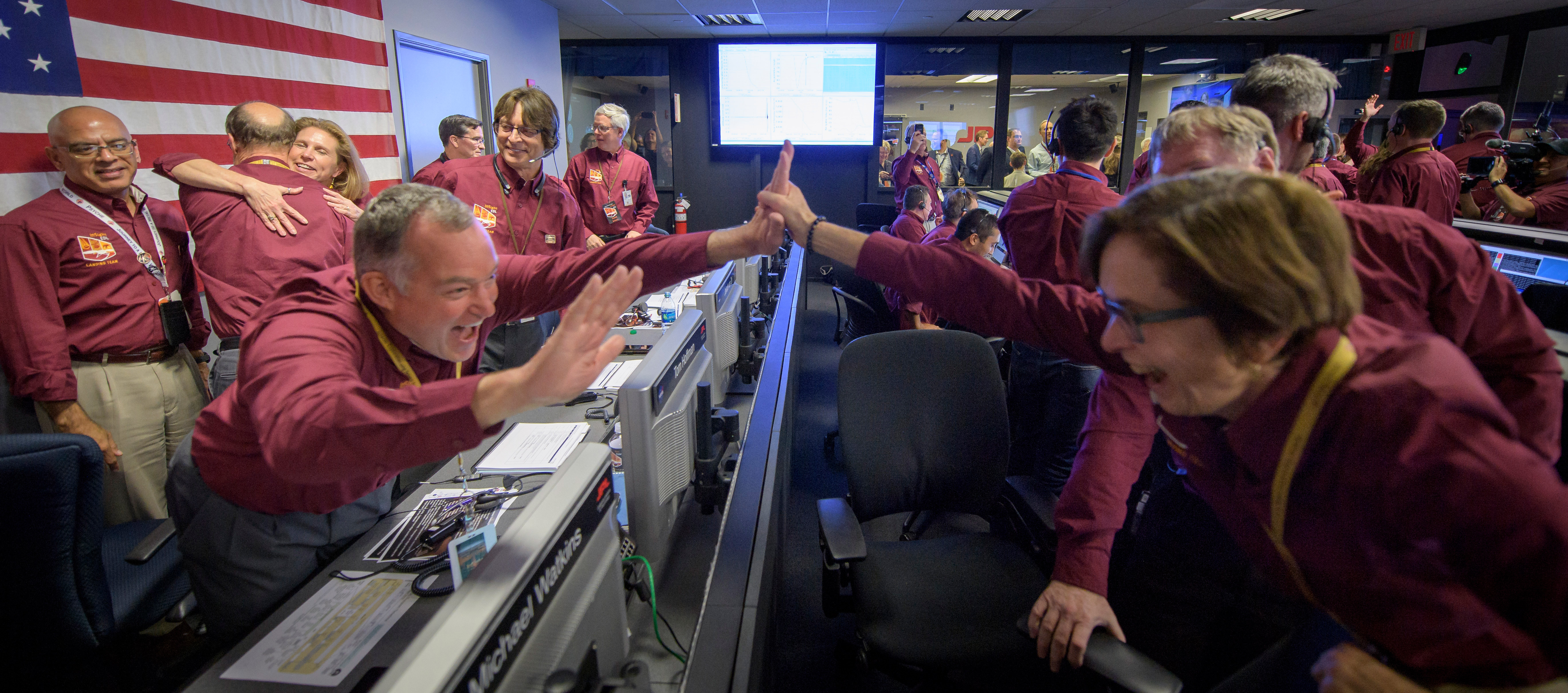Tom Hoffman, InSight Project Manager, NASA JPL, left, and Sue Smrekar, InSight deputy principal investigator, NASA JPL, react after receiving confirmation that the Mars InSight lander successfully touched down on the surface of Mars, Monday, Nov. 26, 2018 inside the Mission Support Area at NASA's Jet Propulsion Laboratory in Pasadena, California.